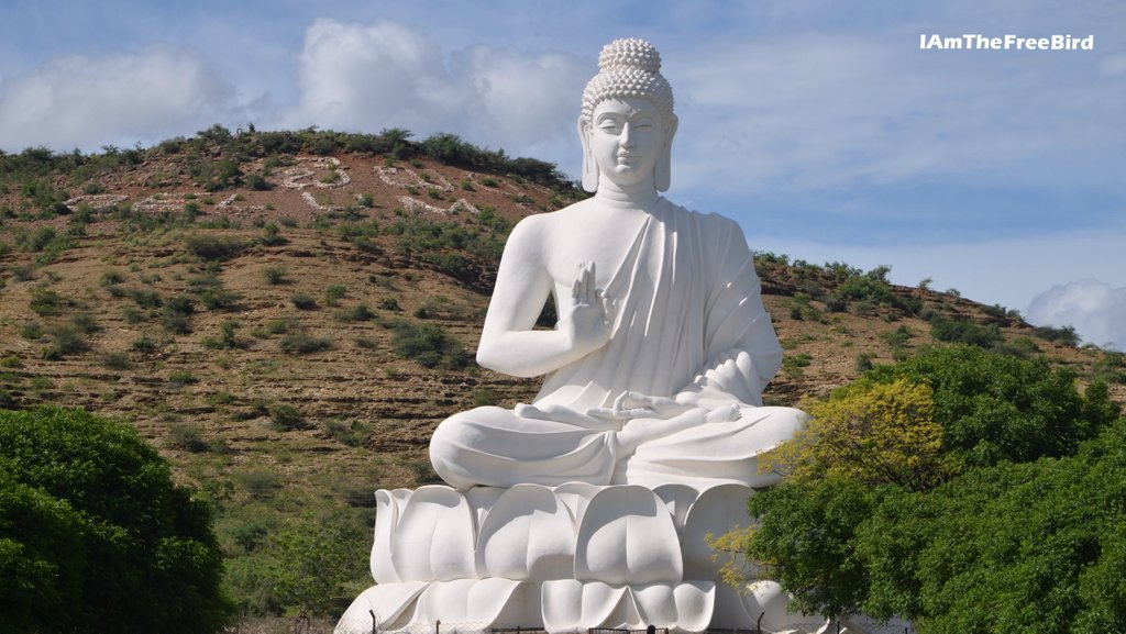 where is belum caves - Buddha at the entrance of belum caves